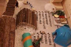 Snowy-enjoying-her-dinner-in-a-custom-size-Hamster-Home